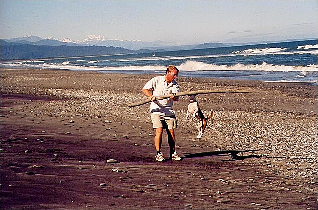 Playing with dog, South Island, New Zealand.
