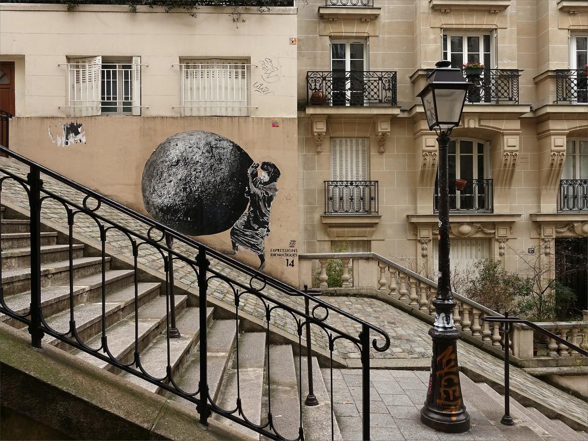 24. Gatukonst vid Montmartre.